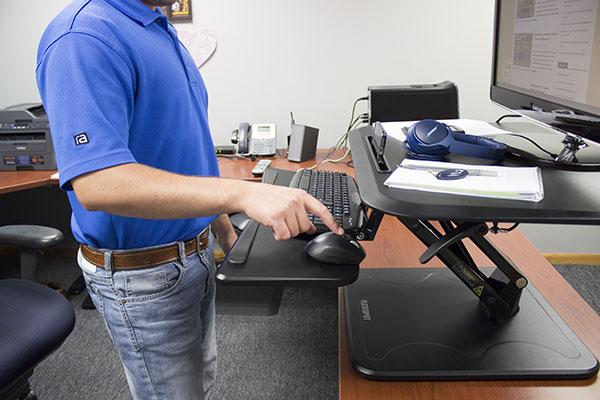 Keyboard tray in negative tilt position