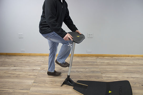 Using foot pedal to lower the seat height