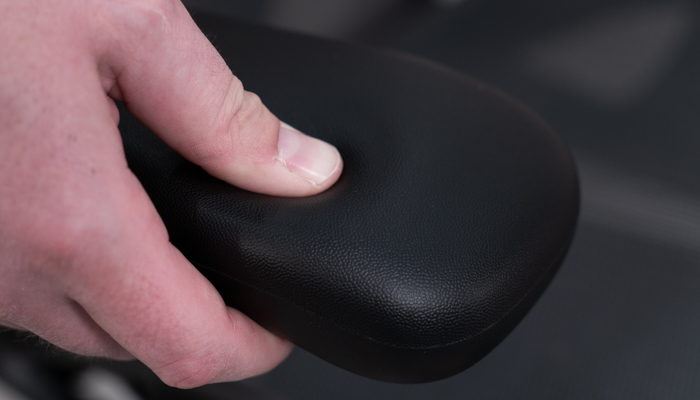 Pressing thumb into arm pad