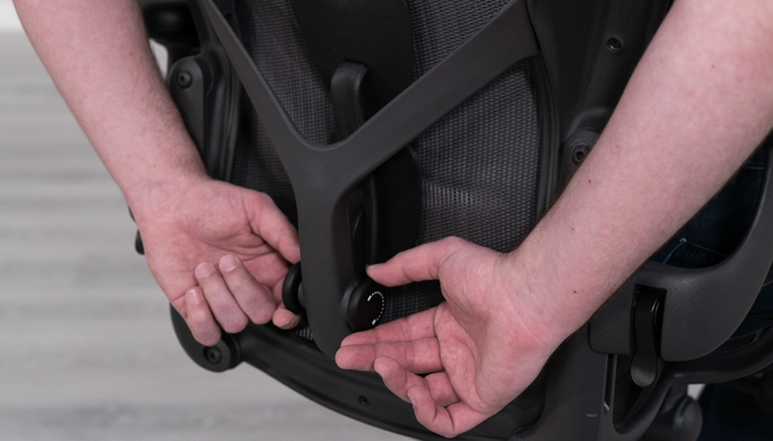 Hands on the Aeron's lumbar support system