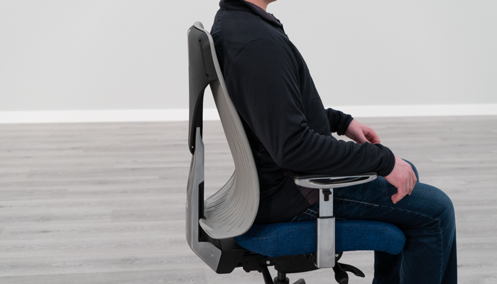 Seated in Truly chair to show lumbar curve
