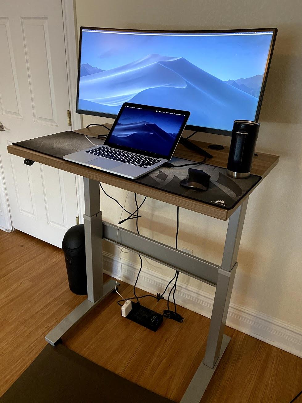 "24"" x 36"" Macchiato Laminate Top with Silver VertDesk Standing Desk Frame"