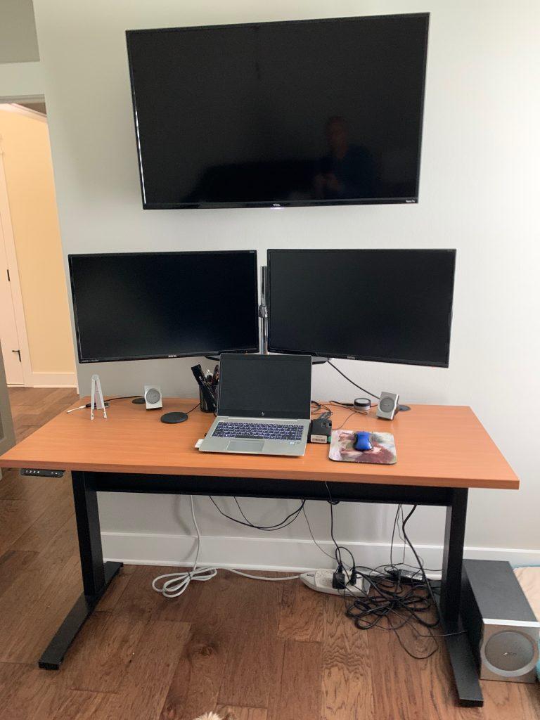 "24"" x 60"" Pearwood Laminate Tope with Black VertDesk Standing Desk Frame"