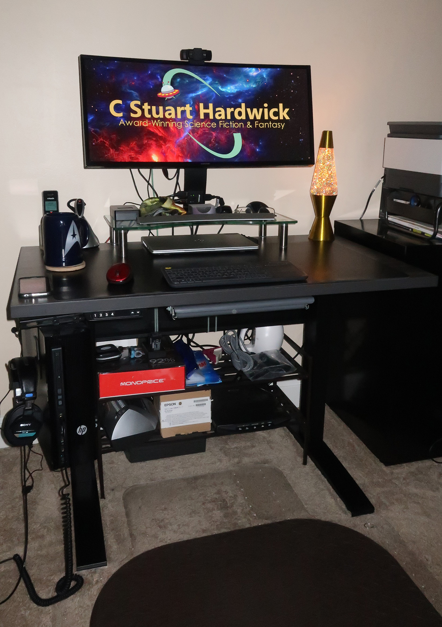 """24"""" x 42"""" Merapi Laminate Top with Black VertDesk Adjustable Desk Frame"""