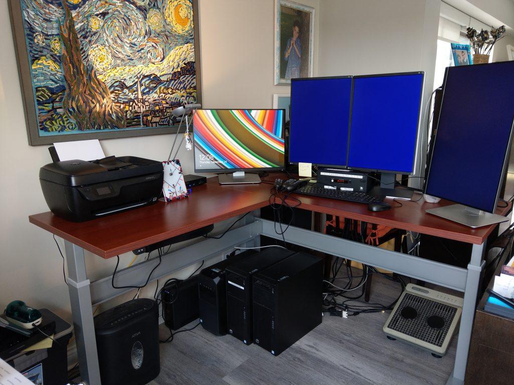 "24"" x 60"" x 60"" x 24"" L Shape Cherry Laminate Top with Silver VertDesk Standup Desk Frame"
