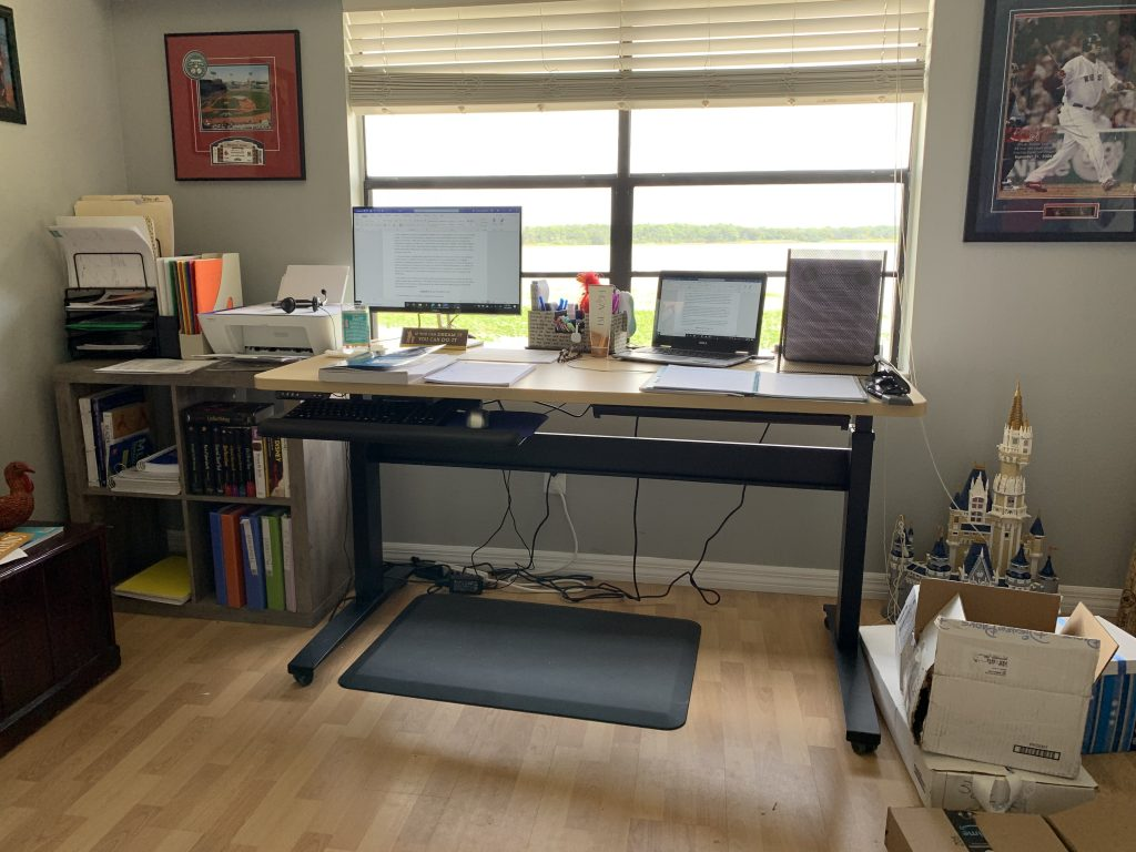 "30"" x 60"" Hardrock Maple Radius Corner Laminate Top with Black VertDesk Standing Desk Frame on Casters"
