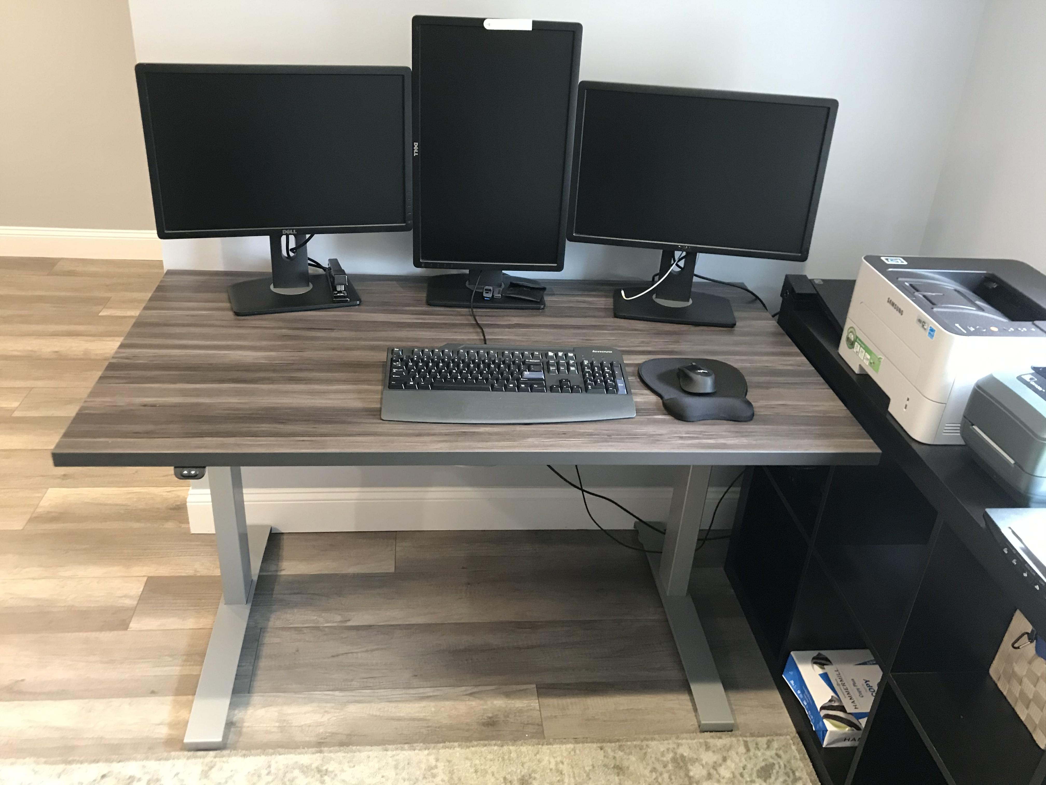 """30"""" x 54"""" Merapi Laminate Top with Silver VertDesk Adjustable Desk Frame"""