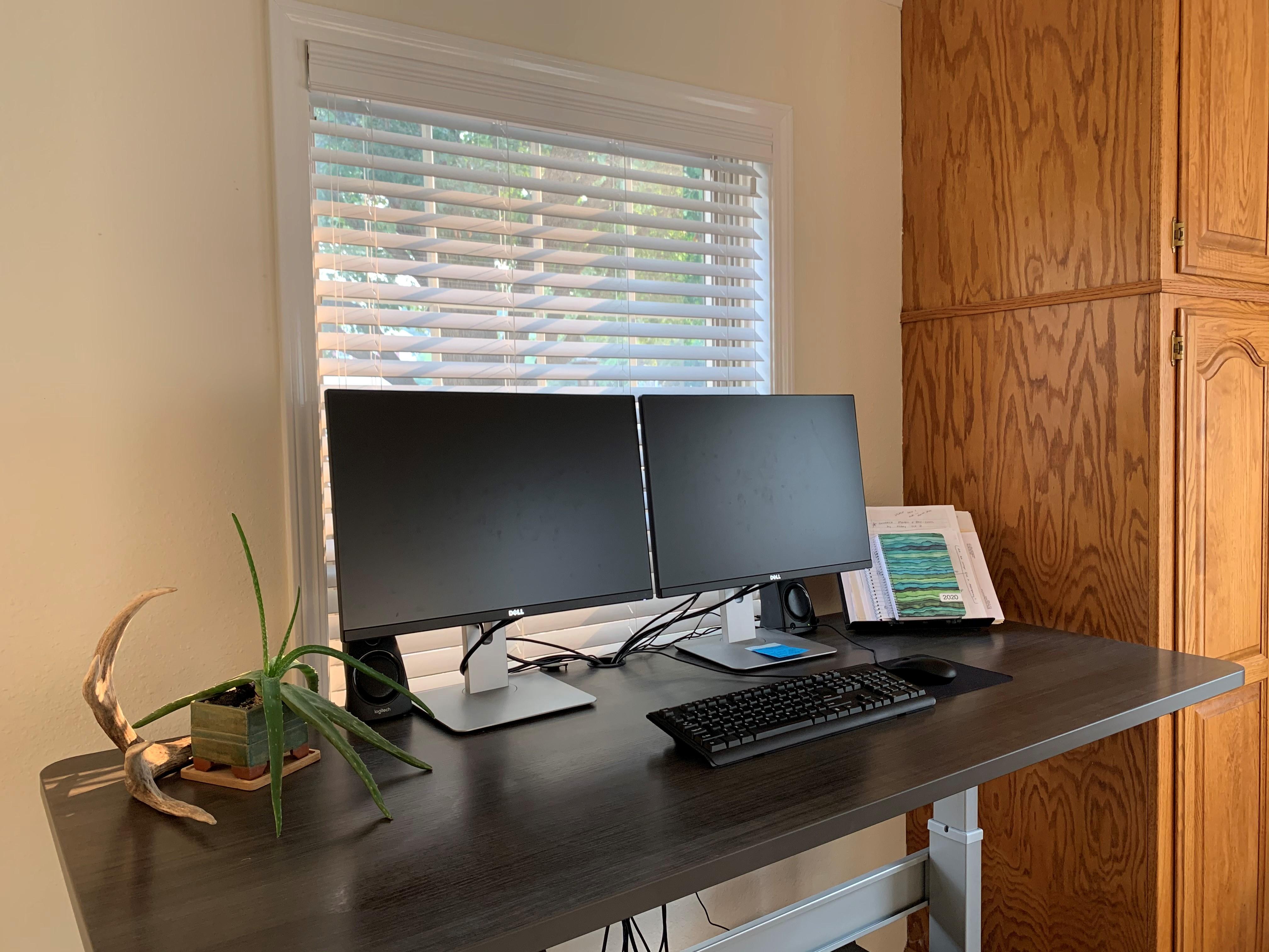"30"" x 70"" Driftwood Laminate Top with Silver VertDesk Adjustable Height Desk Frame"