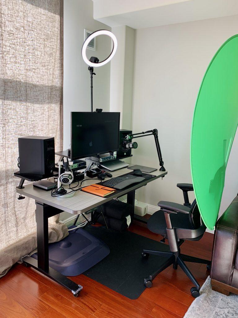 "30 x 60"" Concrete Groovz Laminate Top with Black VertDesk Standing Desk Frame on Casters"