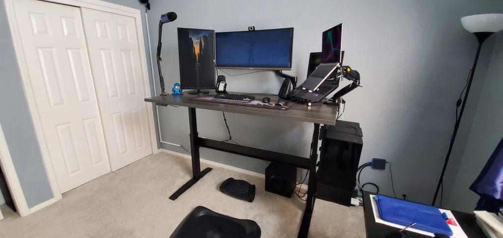 "30"" x 66"" Driftwood Laminate Top with Black VertDesk Standing Desk Frame"