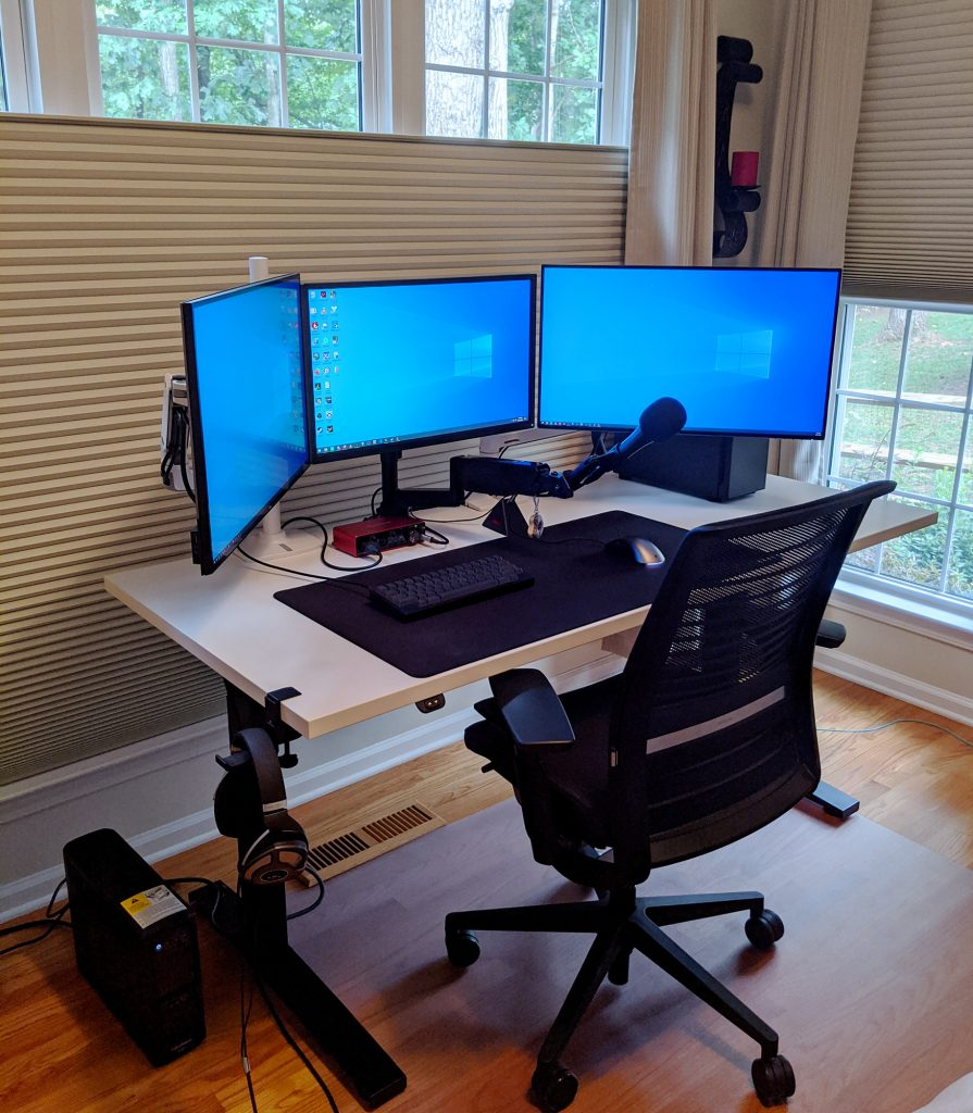 "30"" x 66"" Galaxy White Laminate Top with Black VertDesk Adjustable Height Desk Frame"