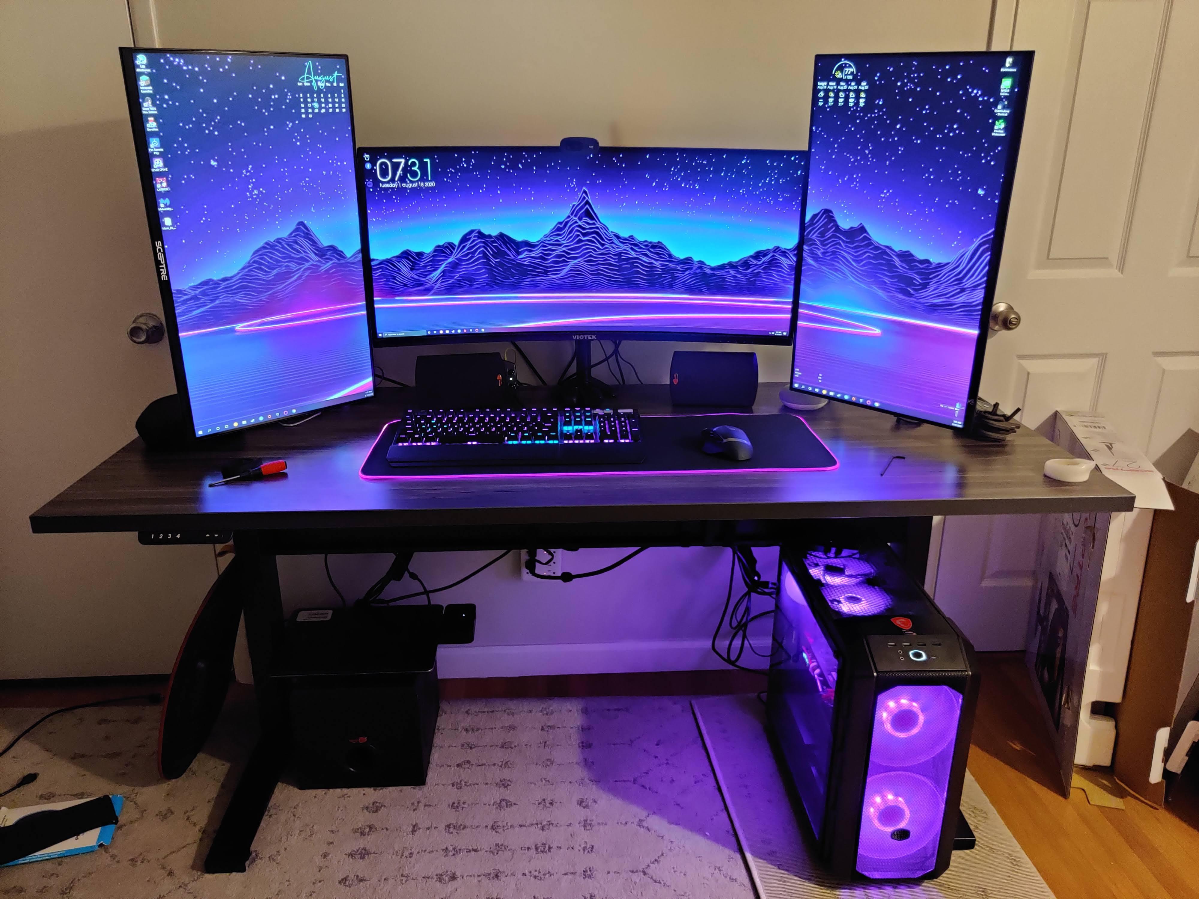 "27"" x 66"" Merapi Laminate Top with Black VertDesk Standing Desk Frame"