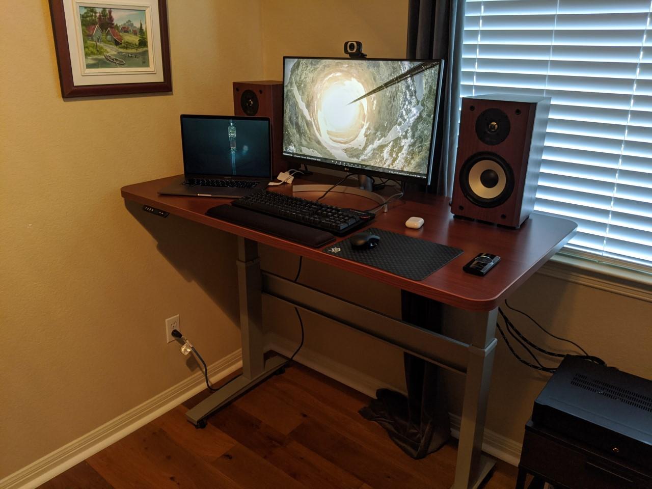 "27"" x 56"" Cherry Laminate Top with Silver VertDesk Standing Desk Frame"