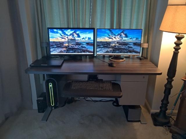 "28"" x 62"" Merapi Laminate Top with Silver VertDesk Standing Desk Frame"