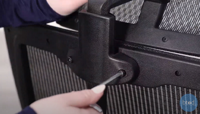 Removing office chair headrest