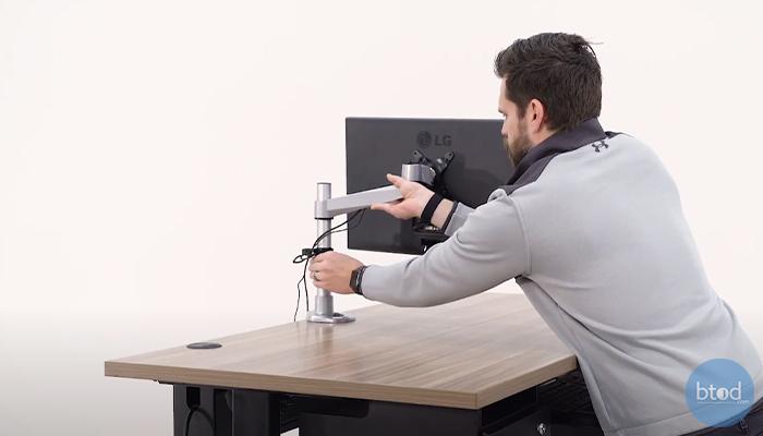 monitor arm height adjustment