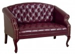 Office Star Traditional Ox Blood Vinyl Reception Love Seat w/ Mahogany Finish